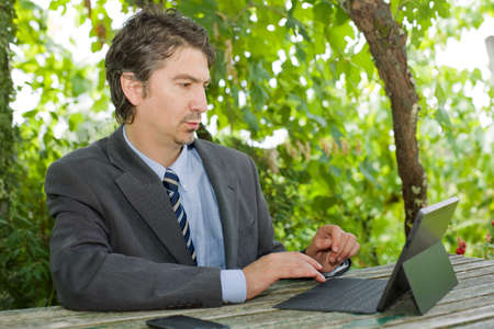 worried businessman: worried businessman with digital tablet, outdoors