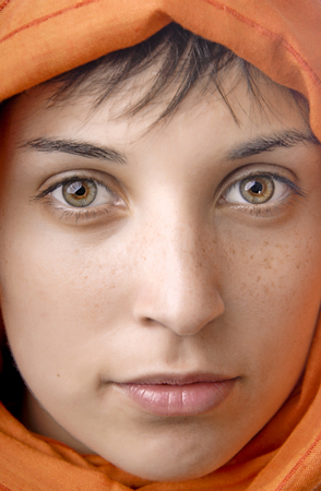 orange veil woman with beautiful eyes, studio picture photo