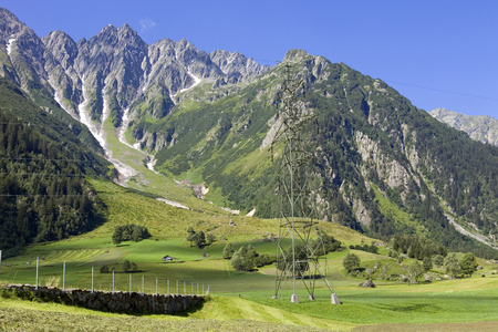 carbon neutral: electricity pylons crossing the Swiss Alps. Bern Canton, Switzerland Stock Photo