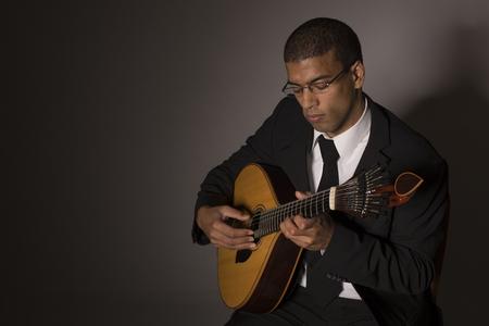 fado musician with a portuguese guitar, studio Stock Photo