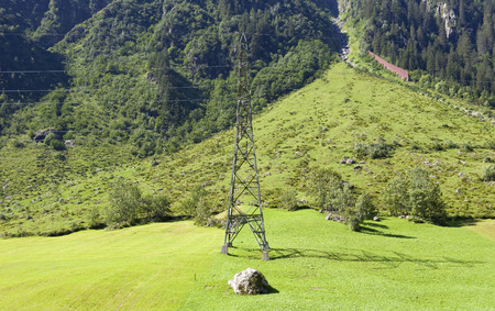 kilowatt: electricity pylons crossing the Swiss Alps. Bern Canton, Switzerland Stock Photo