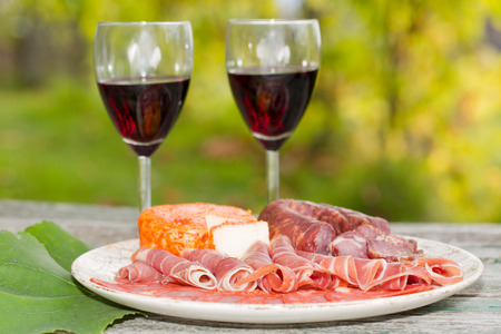 country life: Country life setting with wine, fruits, cheese and meat. Outdoor