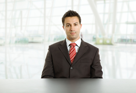 young business man on a desk, at the office photo