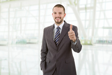 young business man going thumb up, at the office Stock Photo