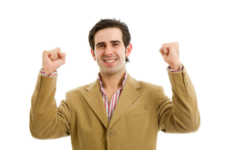 happy young man winning with open arms, isolated on white background photo