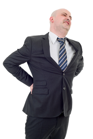 Young businessman with strong back pain, isolated on white background Stock Photo