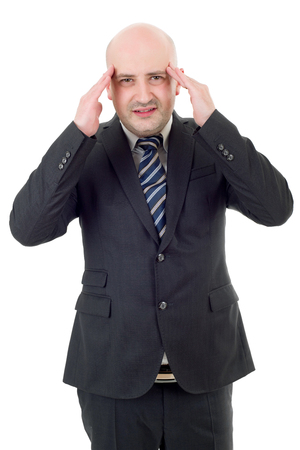 hardworker: Businessman in a suit gestures with a headache, isolated