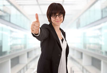 young business woman going thumb up, at the office photo