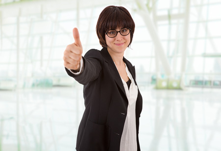 happy business woman going thumb up, at the office photo
