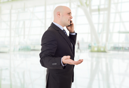 happy business man on the phone, at the office Stock Photo