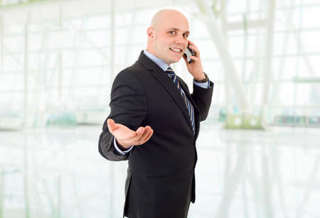 happy business man on the phone, at the office photo
