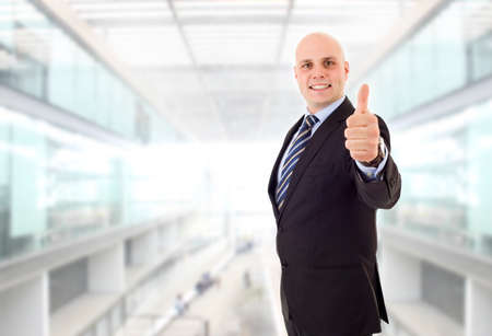 young business man going thumb up, at the office photo