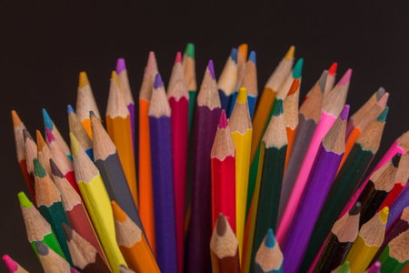 sharpened: Wooden colorful pencils, on a dark background Stock Photo