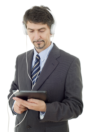 businessman with tablet pc and headphones, isolated photo