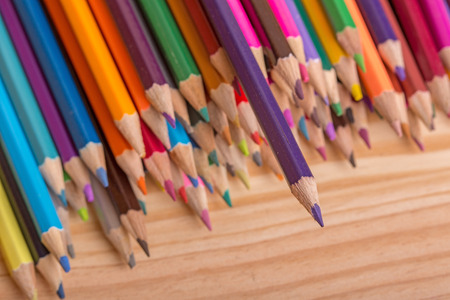 sharpened: Wooden colorful pencils, on wooden table