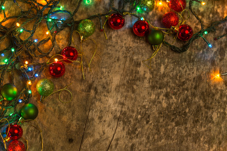 Christmas decoration with lighting, on an old wooden background Stock Photo