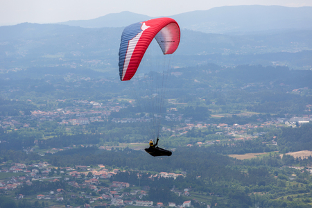 CALDELAS, PORTUGAL - JUNE 4: Paragliding Festival Aboua Cup de Caldelas 2016, in the north of Portugal, 4 June, 2016, Caldelas, Portugal. Editorial