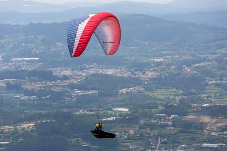 CALDELAS, PORTUGAL - JUNE 4: Paragliding Festival Aboua Cup de Caldelas 2016, in the north of Portugal, 4 June, 2016, Caldelas, Portugal. Editorial