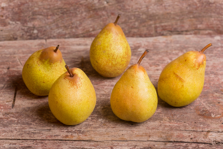 closeup of pears on a old wooden table, studio picture