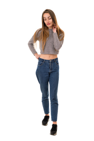 young casual beautiful woman full length, isolated in white