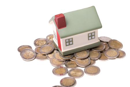 small house and coins, concept, isolated on white background Stock Photo