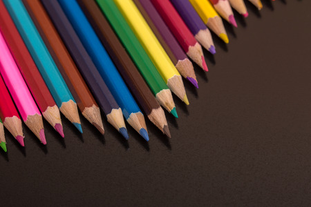 Wooden colorful pencils, on a dark background 版權商用圖片