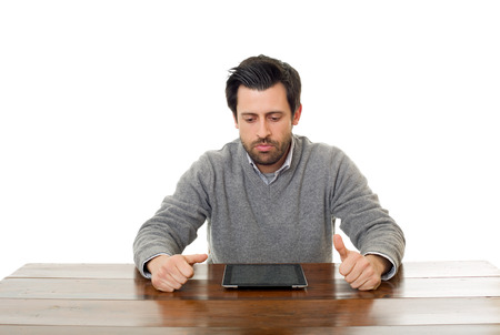 man on a desk working with a tablet pc, isolated Stock Photo