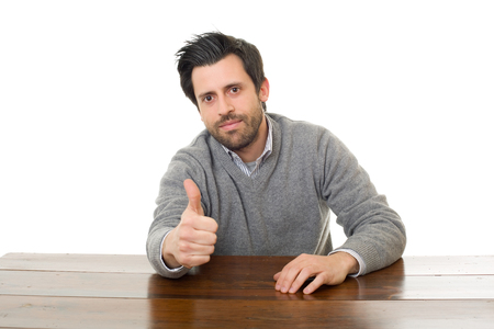 happy man going thumb up, on a desk with a tablet pc, isolated
