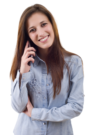 young casual happy woman with a phone, isolated Stock Photo