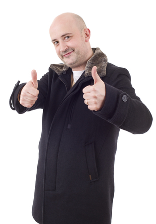 Young casual man going thumbs up, isolated on white background Stock Photo
