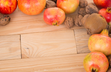 Autumn nature fruits concept. Fall fruits on a wooden table, studio picture Stock Photo