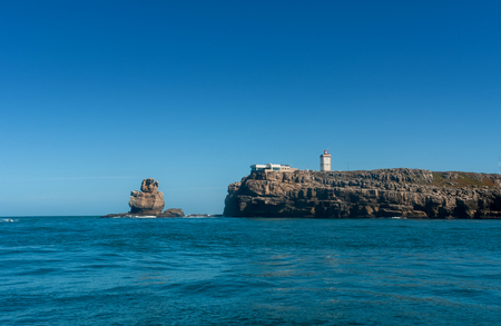 Nau dos Corvos and the Lighthouse of Peniche, Portugal. View from the ocean