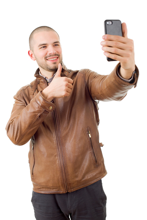 man taking selfie photo with mobile phone camera posing happy and successful isolated on white background