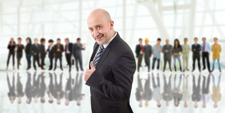 happy business man in front of a group of people