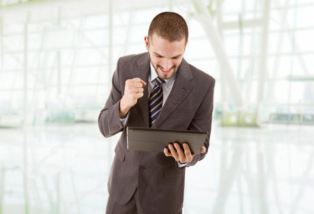 businessman happy using touch pad of tablet pc, at the office Stock Photo