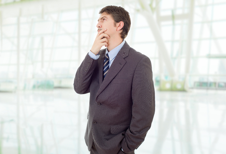 young business man thinking, at the office Stock Photo