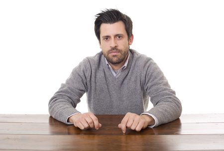 Casual man on a desk, isolated on white background Stock Photo