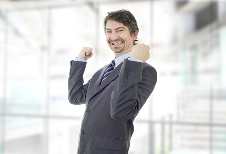 happy business man winning, at the office