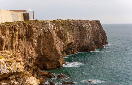 Atlantic ocean coast and Sagres castle on cape. Algarve, southern Portugal.