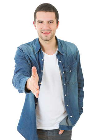 young casual man offering to shake the hand, isolated Stock Photo