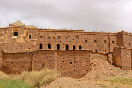 Beautiful old clay building called a kasbah in desert of Morocco, North Africa Stock Photo