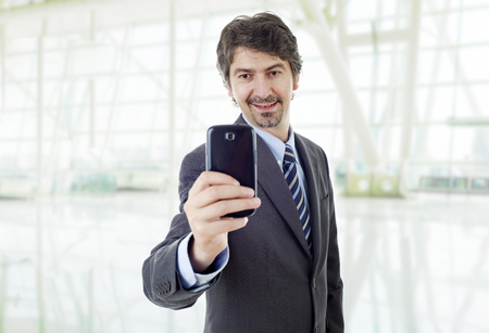 businessman taking a selfie, at the office Stock Photo