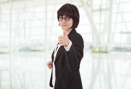happy business woman going thumb up, at the office