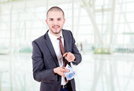 Young business man with money at the office Stock Photo