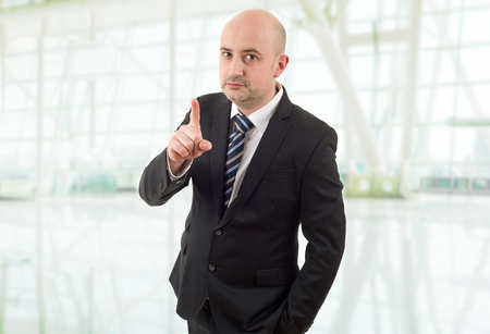 mad business man pointing, at the office Stock Photo