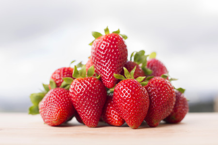 strawberries on gardens table, outdoor picture Stock Photo
