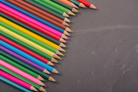 Wooden colorful pencils, on a dark background Stock Photo