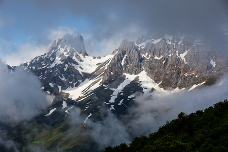 Mountain landscape in the Picos de Europa national park, Spain, Asturias. Snow on the mountain peaks.