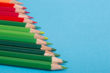 Wooden colorful pencils, on a blue background