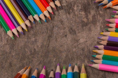 Wooden colorful pencils on a old wooden background